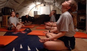 soldiers sitting in tent meditating