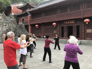 people practicing tai chi at purple cloud temple